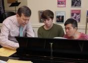 Francis Brancaleone coaching Aaron Kurz and Zhiye Lin