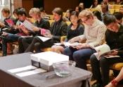 003 2018 contestants examining the program book