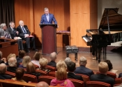 066 Ron Losby, president and CEO of Steinway & Sons officially greeting members of the NYIPC and their families