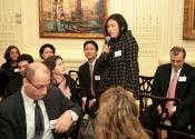 Patty Ju Lee (77-86) speaking to Alumni