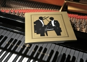 The Program Book and a Steinway