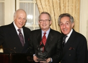 Dr. Gary Ingle presenting MTNA's most prestigious award, The Citation for Leadership, to Melvin Stecher and Norman Horowitz